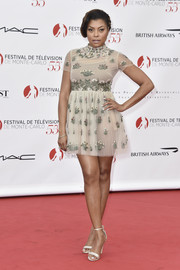 Taraji P. Henson complemented her cute dress with a pair of embellished ankle-strap sandals by Gianvito Rossi.