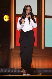 Mickey Guyton donned a black-and-white off-the-shoulder gown with ruffle detailing for the 2021 ACM Awards.