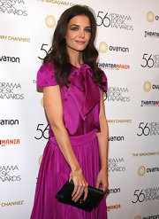 Katie Holmes teamed her feminine fuchsia dress with a black satin envelope clutch.