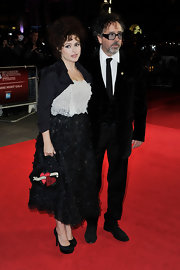 Simple black pumps finished off Helena Bonham Carter's frilly black and white frock.