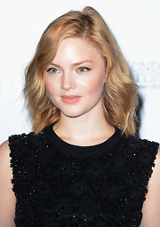 Holliday Grainger chose not to overdo her makeup for a photocall and put on a barely-there nude lip color.