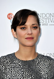 Marion Cotillard proved her reign as an effortless beauty with this barely-there pink lip color.