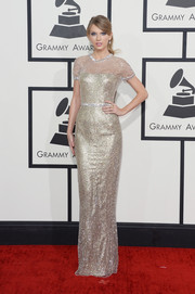 Taylor Swift went for 24-carat glamour in a beaded gold Gucci gown during the Grammys.