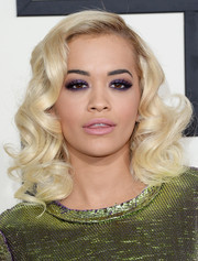 Rita Ora styled her platinum blond locks into an Old Hollywood-inspired curly 'do for the Grammys.