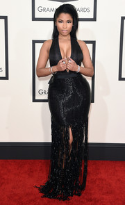 Nicki Minaj looked va-va-voom at the Grammys in a black Tom Ford gown with a down-to-the-navel neckline and a beaded, fringed skirt.