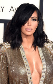 Kim Kardashian was sexily coiffed with tousled waves during the Grammys.