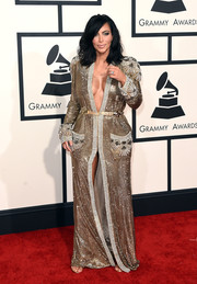 Kim Kardashian took an exotic turn in a robe-like, fully beaded gold Jean Paul Gaultier Couture gown for the Grammys. Of course, it wouldn't be Kim without the plunging neckline.