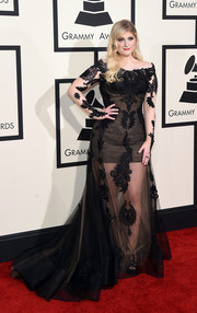 Meghan Trainor went for a princess-gone-wild vibe in a sheer black Galia Lahav off-the-shoulder gown with a mini-dress underlay.