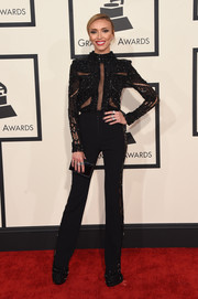 Giuliana Rancic attended the Grammys rocking an embellished, sheer-panel jumpsuit by Inbal Dror.