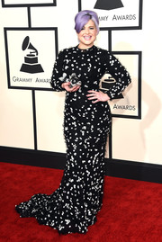 For her Grammys red carpet look, Kelly Osbourne chose a black Christian Siriano gown adorned with clusters of silver sequins.