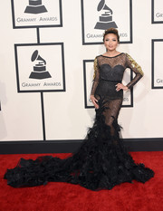 For her Grammys look, Jeannie Mai got all frilled up in a sheer black Ali Younes gown with a voluminous train and gold accents on the sleeves.