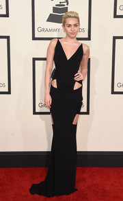 Miley Cyrus donned yet another skin-revealing number for her Grammys look, a black Alexandre Vauthier Couture gown with a plunging neckline and multiple cutouts.