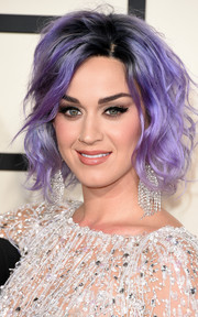 Katy Perry topped off her sparkly ensemble with a pair of diamond chandelier earrings.