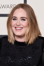Adele opted for an edgy center-parted layered cut when she attended the Grammys.
