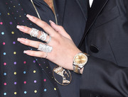 Zendaya Coleman rocked a luxurious gold and diamond watch by Rolex at the 2016 Grammys.