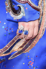 Lady Gaga got all blinged up with a pair of massive blue gemstone rings for the Grammys.