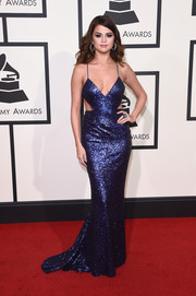 Selena Gomez vamped it up at the Grammys in a slinky indigo sequin gown with waist cutouts and a plunging neckline.