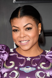 Taraji P. Henson went for a simple half-up style when she attended the 2017 Grammys.