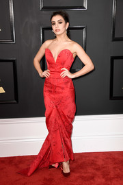 Charli XCX complemented her dress with a pair of red satin pumps.