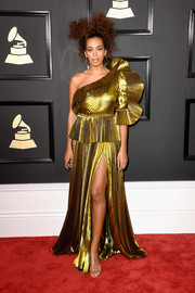 Solange Knowles looked very fancy at the Grammys in a gold Gucci one-shoulder gown with a peplum waist and a ruffle sleeve.