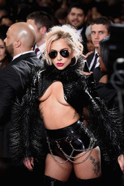 Lady Gaga matched a pair of chain-embellished hot pants with a cleavage-revealing jacket for her 2017 Grammys look.