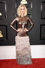 Katy Perry continued the flamboyant vibe with a long feather skirt, also by Tom Ford.