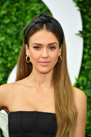 Jessica Alba polished off her look with a pair of gold hoops by Jennifer Fisher.