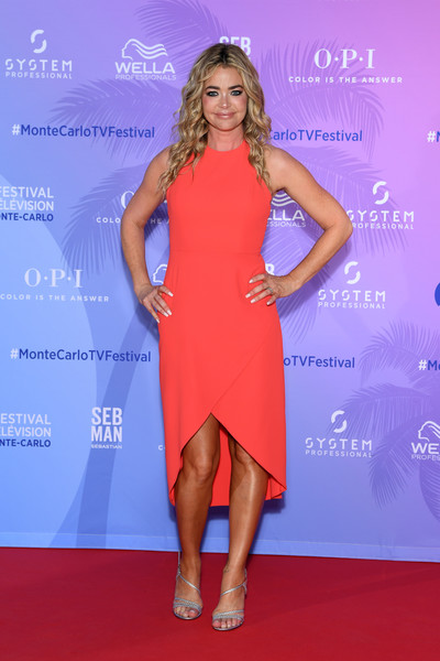 Denise Richards opted for a simple red dress with a high-low hem when she attended the Monte Carlo TV Festival series party.