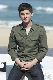Logan Lerman's fatigue-inspired olive button-down at the 'Three Musketeers' photocall gave him a tough aura.