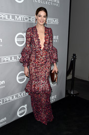 Michelle Monaghan paired her dress with an elegant bronze clutch.