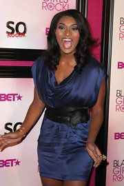 Toccara Jones showed off her curves by wearing a wide leather belt on top of her flowy dress.