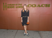 Suki Waterhouse chose a pair of black-and-white tassel loafer heels, also by Coach, to finish off her outfit.