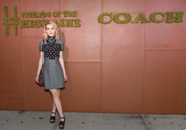 Kiernan Shipka's black Coach wedges added a '60s vibe to her look.