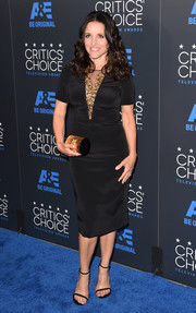 Julia Louis-Dreyfus continued the gold and black theme with an Edie Parker tube clutch.