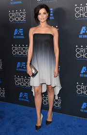For a dose of shine, Jaimie Alexander accessorized with a metallic silver clutch.