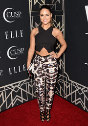 Pia Toscano teamed her crop-top with abstract-print pants for a totally modern finish.