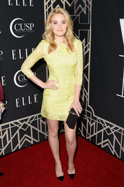 Amanda Michalka complemented her outfit with a classic black frame clutch with floral accent.