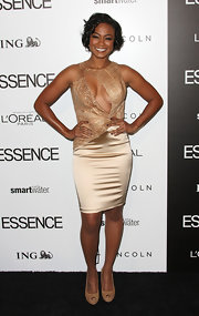 Tatyana Ali wore this racy gold satin dress to the Essence Luncheon.