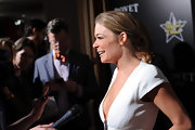 LeAnn Rimes attended the 5th Annual Hollywood Domino Gala wearing her hair in a chic chignon.