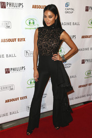 Nicole Scherzinger opted for a black lace-bodice jumpsuit when she attended the Imagine Ball.