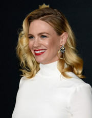January Jones polished off her look with a pair of dangling diamond earrings.