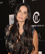 Demi Moore brought a boho vibe to the PSLA Autumn Party with this long center-parted wavy hairstyle.