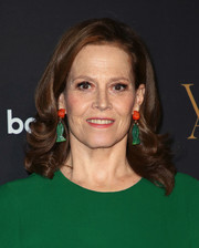 Sigourney Weaver went for playful styling with a pair of dangling fish earrings.