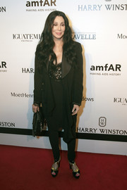 Cher rocked a draped black tuxedo at the amfAR Inspiration Gala Sau Paolo.