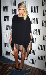 Kesha channeled vintage '20s glamour in this bronze-bordered shift dress at the BMI Pop Awards.