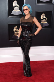 Jenny McCarthy shimmered on the Grammys red carpet in a sheer-panel black sequin gown by Tom Ford.