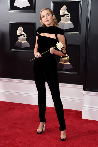 A pair of platform sandals with clear straps and chunky silver heels finished off Miley Cyrus' look.