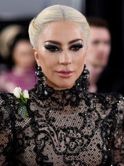 Lady Gaga pulled her head-turning look together with a pair of black chandelier earrings by Lorraine Schwartz.
