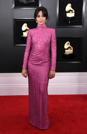 Camila Cabello looked festive in a micro-beaded fuchsia column dress by Armani Prive at the 2019 Grammys.