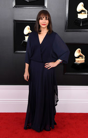 Rashida Jones went for a loose navy wrap gown by Ralph Lauren at the 2019 Grammys.